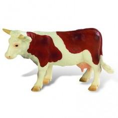Figurine vache marron/blanche