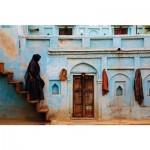 Puzzle 1000 pièces : National Geographic : Sari rouge et façade bleu pastel