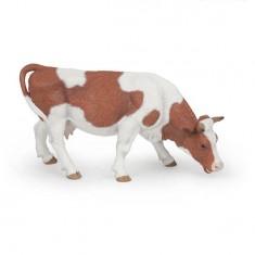 Figurine vache Simmental broutant