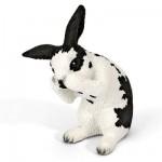 Figurine lapin faisant sa toilette