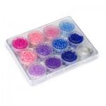 Petit coffret de perles : violettes, roses et bleues